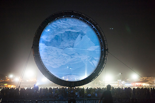 large circle over crowd with projection of ice